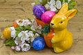 Easter stilllife still life with little porcelain bunny and spring flowers on wood background Royalty Free Stock Photography