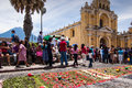 Easter sunday flower carpet antigua guatemala april processional made of flowers in front of hermano pedro church agua volcano is Royalty Free Stock Photos