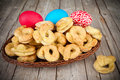 Easter sweet bagels and colored eggs in basket Royalty Free Stock Photos