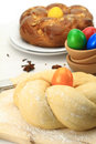 Easter sweet bread dough with multicolored eggs Royalty Free Stock Photo