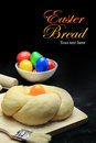Easter sweet bread dough with multicolored eggs on black background Royalty Free Stock Photos