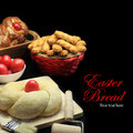 Easter sweet bread dough with red eggs on black background Royalty Free Stock Photos