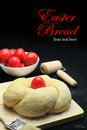 Easter sweet bread dough with red eggs on black background Stock Photography