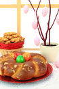 Easter sweet bread with multicolored eggs and shortbread cookies Stock Image