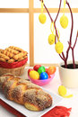 Easter sweet bread with multicolored eggs and shortbread cookies Stock Photos
