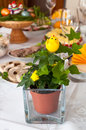 Easter table detail plant composition in a pot with chicken set as decoration on a festive Royalty Free Stock Images