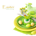 Easter table setting with chickeh candle and colorful eggs Stock Images