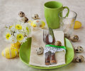 Easter table setting with flowers and egg Stock Photo