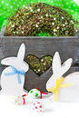 Easter time decorations with white wooden bunnies and spring wreath Royalty Free Stock Images