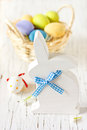 Easter time decorations with white wooden bunny and colorful eggs Royalty Free Stock Photos