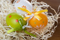 Easter time eggs in the straw Royalty Free Stock Photos