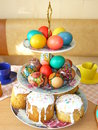 Easter treats coloured eggs and cakes Stock Image
