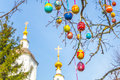Easter tree eggs with the Church in the background Royalty Free Stock Photo