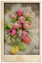 Easter tulip flowers bouquet with eggs vintage postcard style antique cardboard isolated on white background Royalty Free Stock Photography