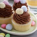 Easter vanilla cupcakes with chocolate frosting Royalty Free Stock Photo