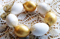 Easter white and gold eggs shells wreath Stock Photos