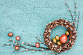 Easter willow wreath and colorful easter eggs on blue background top view copy space Stock Image