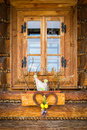 Easter window decoration an a rustic wooden cottage Stock Photography