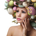 Easter woman spring girl with fashion hairstyle portrait of beautiful model with colorful eggs Royalty Free Stock Photo