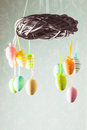 Easter wreath with color eggs on ribbons Stock Image