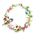 Easter wreath with colored eggs, bird in grass, flowers. Round frame. Watercolor
