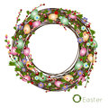 Easter wreath of colored eggs and flowers gentle woven dry twigs wildflowers yagod in gentle pastel Stock Photography