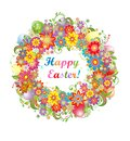 Easter wreath with colorful flowers and saturated eggs Royalty Free Stock Photo