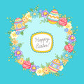 Easter wreath greeting card floral with eggs on blue background Royalty Free Stock Images