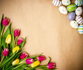 Eastern egg, tulips on brown wrapping paper