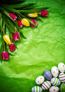 Eastern egg, tulips on green crumpled wrapping paper