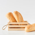 Eastern Europe long loaf bread on white background. Royalty Free Stock Photo