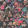 Eastern floral seamless print on striped denim backdrop. Bright doodle flowers on a dark gray background, color graphics