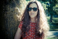 Eastern hipster vintage woman with shades at the park Royalty Free Stock Photos