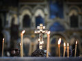 Eastern orthodox cross in a church with candles Stock Images