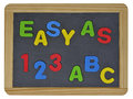 Easy as abc in colored letters on slate written traditional Royalty Free Stock Images