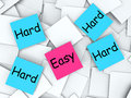 Easy hard post it notes mean effortless or meaning challenging Royalty Free Stock Images