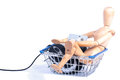 Easy internet shopping a wooden puppet busy with on the sitting in a basket with a mouse and a wallet with a credit card Stock Photo