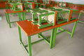 Easy movable orange and green wooden tables and chairs for using in any open area events. The open area such as beer yard, beer ga Royalty Free Stock Photo
