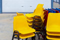 Easy movable yellow plastic chairs for using in any open area events. The open area such as beer yard, beer garden, public cafe, o Royalty Free Stock Photo