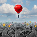 Easy way forward rise above confusion leadership concept with a businessman in a balloon flying and soaring over a complicated Royalty Free Stock Image