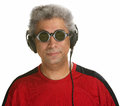 Easygoing man with headphones arab sunglasses and Stock Images