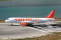 Easyjet airbus on runway an a taxies onto the turning circle at corfu airport Stock Photos