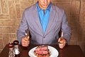 Eat a beef steak man holding knife and fork ready to Royalty Free Stock Image