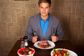 Eat a beef steak man holding knife and fork ready to Royalty Free Stock Photos