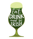 Eat, drink and be irish. Funny St. Partick`s day quote. Typography on glass with green beer isolated on white background