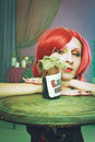 Eat me portrait of redhead alice looking at can with label Stock Images