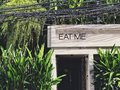 EAT ME sign Front gate of garden style cafe and restaurant