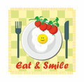 Eat & Smile - tomato and fried egg Royalty Free Stock Photo