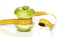 Eaten green apple and a measuring tape isolated Royalty Free Stock Image
