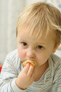 Eater little boy gobbling sweet pancake Stock Image
